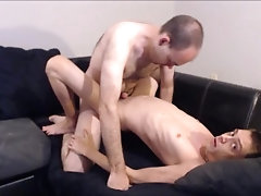 Daddy fucking his boy on the couch