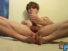 Handsome twink Billy shoots a load on his feet with pleasure