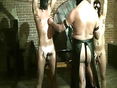 2 slaves strung up and whipped
