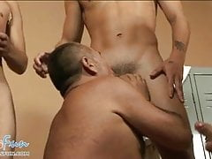 Gay daddy gives multiple blowjob in a locker room